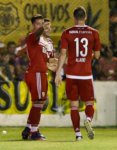BAHIA BLANCA, ARGENTINA - DECEMBER 18: Sebastian Driussi of River Plate celebrates with teammates Lucas Alario and Camilo Mayada after scoring the second goal of his team during a match between Olimpo and River Plate as part of Torneo Primera Division 2016/17 at Roberto Natalio Carminatti Stadium on December 18, 2016 in Bahia Blanca, Argentina. (Photo by Gabriel Rossi/LatinContent/Getty Images)
